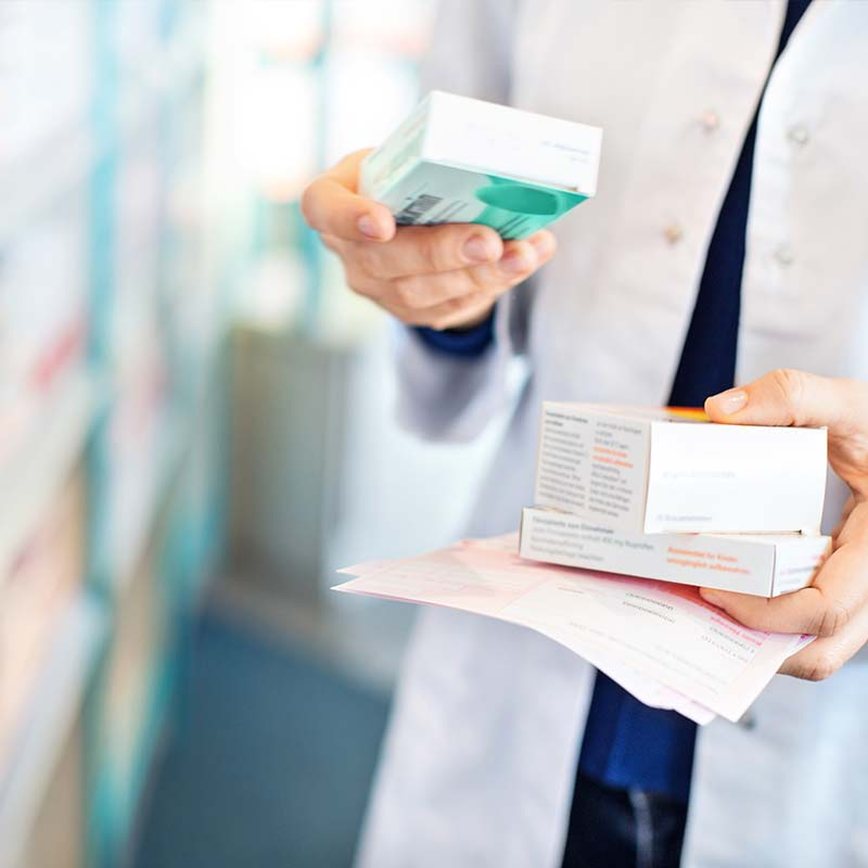 Doctor holding prescriptions in Americraft packaging
