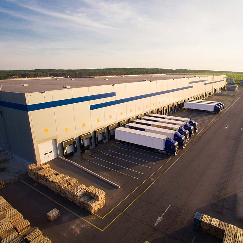 Americraft shipping facilities with trucks ready to deliver cartons